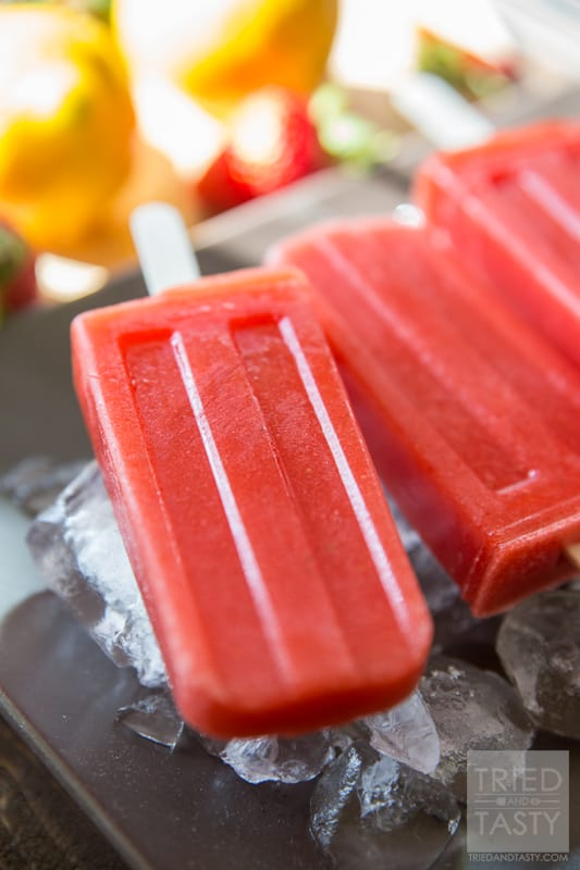 Sweet & Tart Strawberry Lemon Popsicles // Ever made your own popsicles at home? They so simple it's almost hard to believe. You get to avoid yucky artificial flavorings, colors, and ingredients and can feel great about what you are feeding your family! Made with only fruits, you'll love the taste of these sweet & tart popsicles! | Tried and Tasty