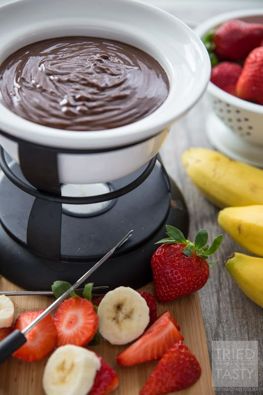 Three Ingredient Peanut Butter Fondue // Calling all peanut butter lovers! This fondue is perfectly creamy, perfectly chocolaty, and perfectly peanut buttery! Grab your favorite dippers and whip this delicious dessert up in a breeze! | Tried and Tasty