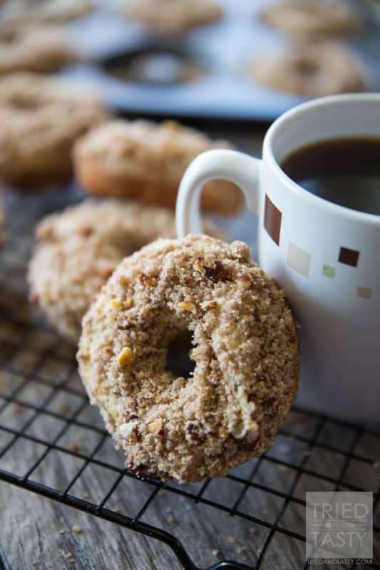 Baked Coffee Cake Doughnuts // You love coffee cake, but do you love coffee cake DOUGHNUTS? The answer is yes. I know. You haven't tried them yet. The answer is still yes. These delicious doughnuts pair perfectly with your coffee for breakfast in the morning. They are a cinch to whip together and will be gone before you know it (better make a double batch to begin with!)   Tried and Tasty