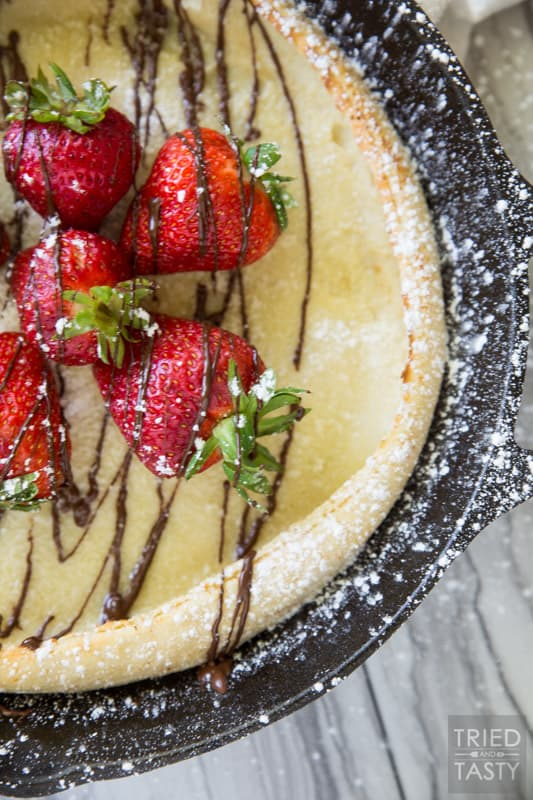Dutch Baby Pancakes // You've had a german pancake (or Dutch Baby as they are also called) but have you had this delightful chocolate covered strawberry version? Probably not... but I'm here to change that. This would be the most excellent breakfast to wake up to! | Tried and Tasty