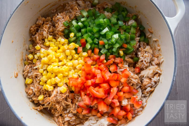 Chicken Taco Rice Salad // Want an easy weeknight meal that the whole family will love? Try this super family friendly flavor packed chicken dish on your next menu! Serve it atop Fritos corn chips, sprinkled with fresh cheddar cheese and you've got an out of this world dinner! One to be made again and again! | Tried and Tasty