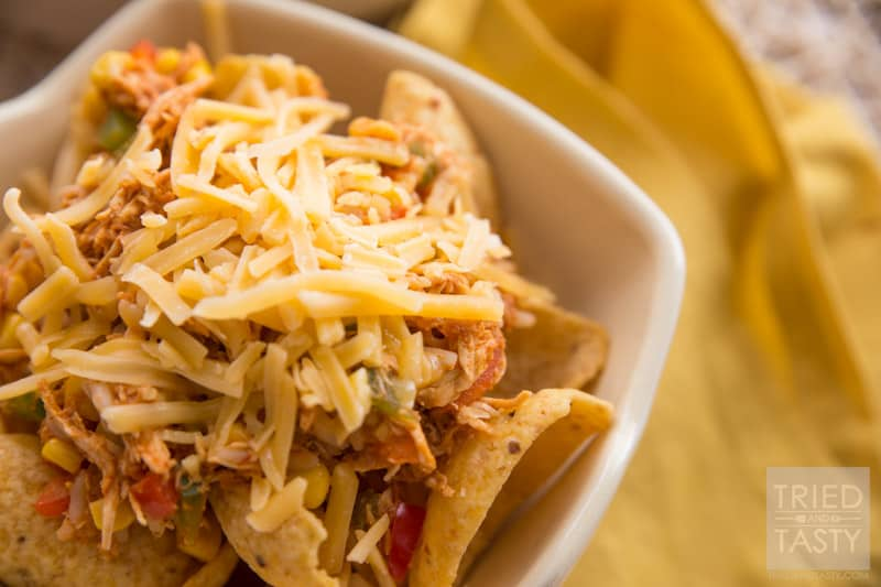 Chicken Taco Rice Salad // Want an easy weeknight meal that the whole family will love? Try this super family friendly flavor packed chicken dish on your next menu! Serve it atop Fritos corn chips, sprinkled with fresh cheddar cheese and you've got an out of this world dinner! One to ba made again and again! | Tried and Tasty