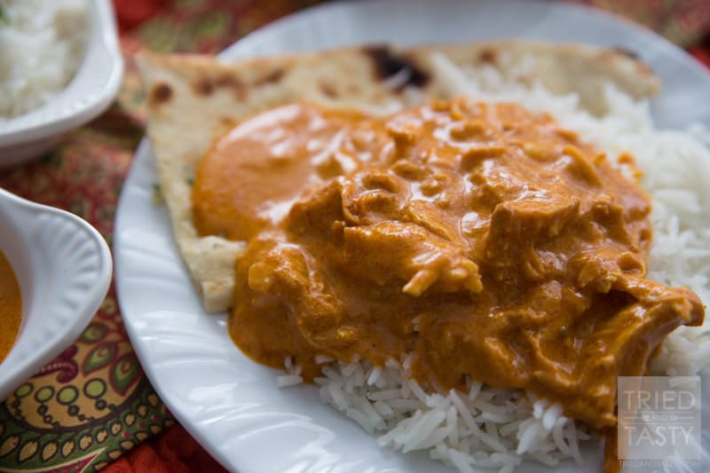 Slow Cooker Easy Indian Butter Chicken // If you have never tried Indian food, this is a MUST MAKE (next to Chicken Tikka Masala). It's made easy with the help of your slow cooker. Packed with flavor, your family will fall in love with the tasty bold flavors! Serve with basmati rice and garlic naan for a delicious traditional meal. | Tried and Tasty