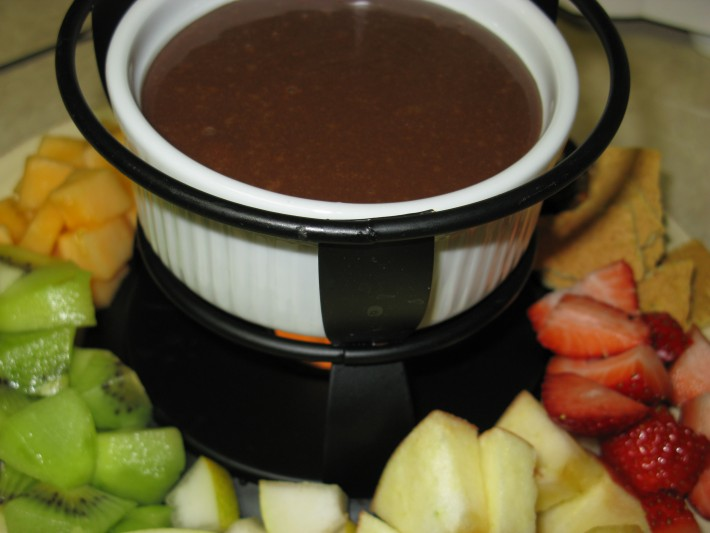 Light and Dark Fondue // The most delicious fondue you'll ever have that's made with Hershey's Hugs! It's smooth and creamy and perfect with any dipper! | Tried and Tasty