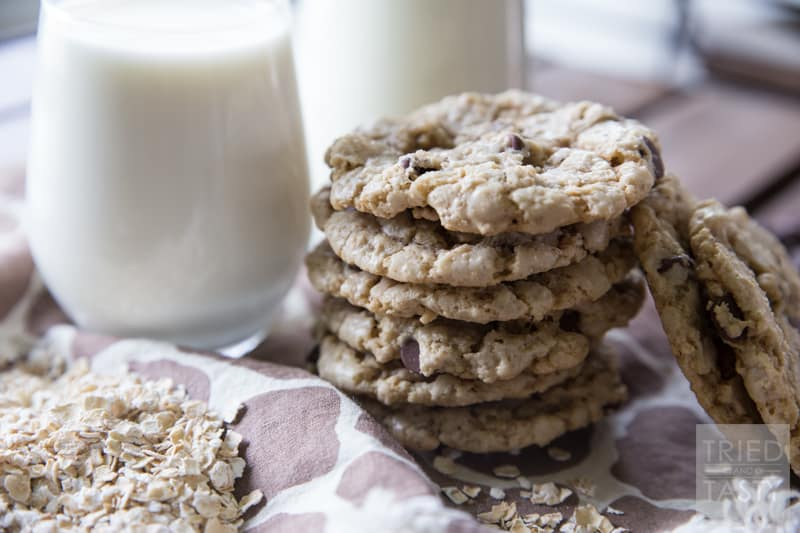 Crunchy Oatmeal Chocolate Chip Cookies // Looking for a little 'crunch' in your cookie? These are absolutely perfect! Just the right amount of crispness surrounded by oodles of chocolate chips and oatmeal. Whip these cookies up in no time! | Tried and Tasty