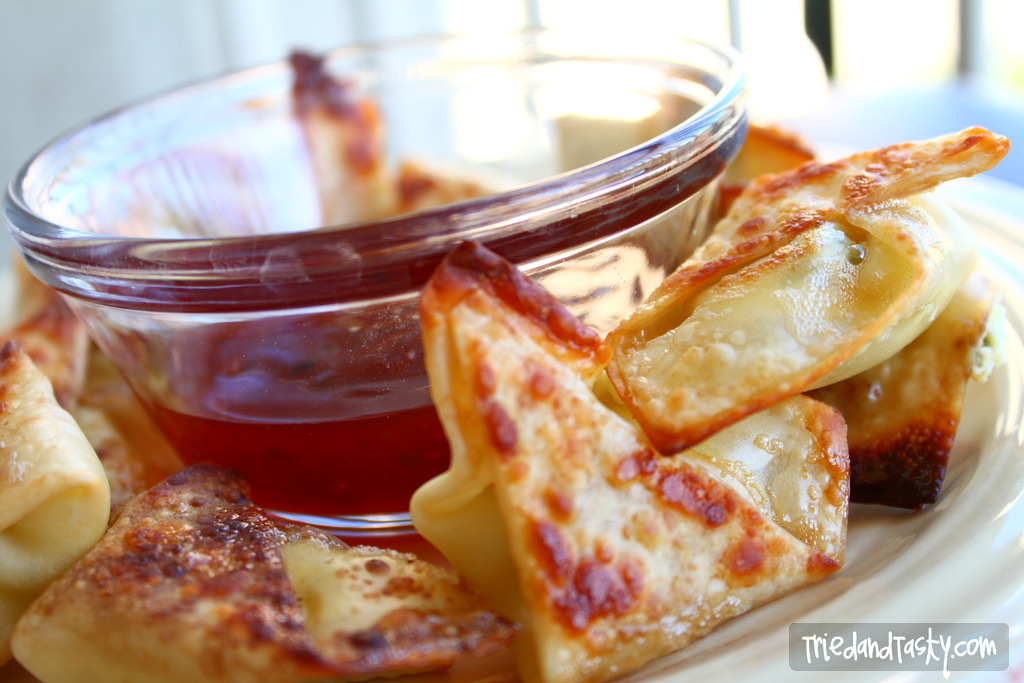 Baked Cream Cheese Wontons // These are the perfect appetizer. With a cream cheese filling, you'll love these nearly guilt free finger foods even more because they are baked! Serve with sweet & sour sauce right before your favorite Chinese dinner made at home.   Tried and Tasty