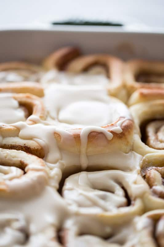 Close up shot of cinnamon rolls with maple icing