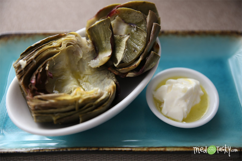 Grilled Artichokes // These grilled artichokes so tasty and pair well with a simple dipping sauce! | Tried and Tasty
