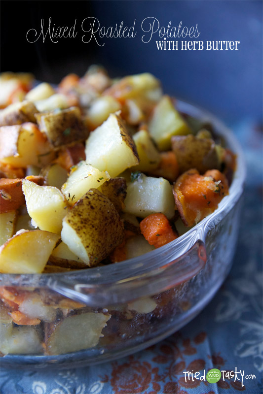 Mixed Roasted Potatoes with Herb Butter // This roasted potatoes recipe has all three of the top favorite: white, red, and sweet potatoes.   Tried and Tasty