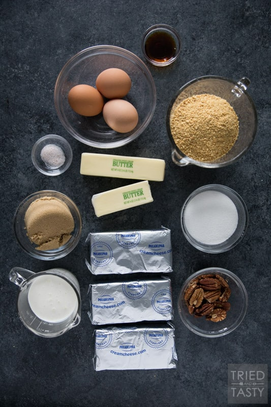 Ingredients for cheesecake: cream cheese, heavy cream, brown sugar, butter, graham cracker crumbs, eggs, etc.