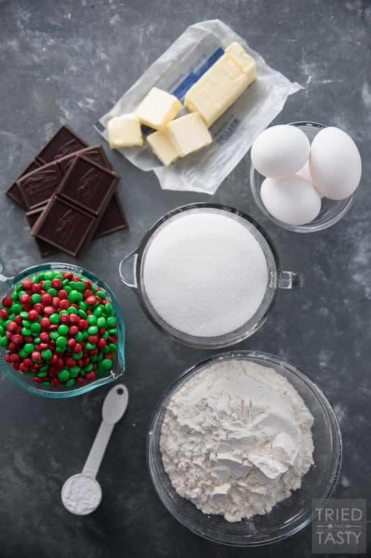 Ingredient layout of flour, sugar, eggs, butter, chocolate, M7M's and baking soda