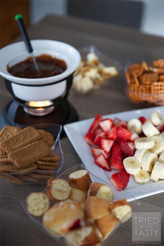 Chocolate Bar Fondue // This wonderful fondue pairs a delicious creamy cheese with sweet raspberries for an out of this world combination. You'll love the sweet surprise! | Tried and Tasty
