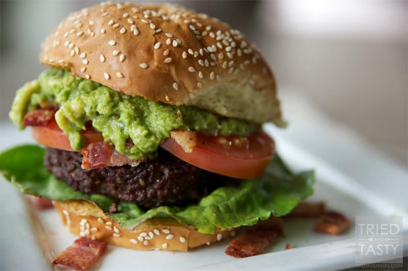 Guacamole Bacon Burger // If you love guacamole, you'll love this burger. It's got the wonderful flavors of guacamole paired with bacon on top of a well-seasoned grilled burger. You won't be disappointed! | Tried and Tasty