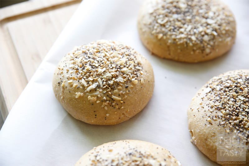 Homemade Whole Wheat Everything Hamburger Buns // If you are familiar with the 'everything' bagel and love it, you will love this hamburger bun. If you aren't familiar with it, you have GOT to give this a try. The smell alone of these baking in the oven is enough to make your senses run wild! | Tried and Tasty