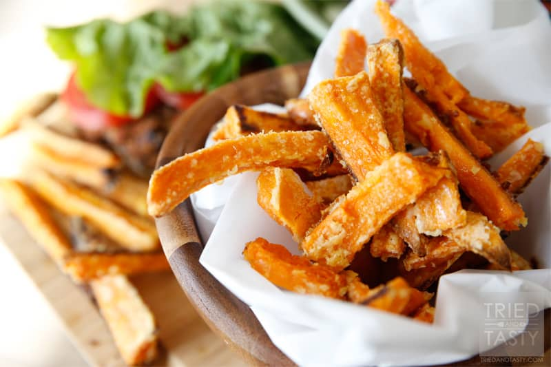 Oven Baked Crispy Sweet Potato Fries // Why buy frozen sweet potatoes when you can make some that are even more amazing? These will change your life! The secret ingredient will leave you pleasantly surprised! | Tried and Tasty