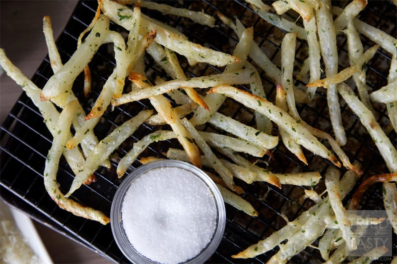 Double-Baked Crazy-Crisp Parmesan Oven Fries // A crispy fry that's oven baked for a healthier alternative to the traditional deep fried. Throw in some parmesan cheese and you've got the tastiest fries around! | Tried and Tasty