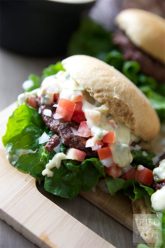 Queso Blanco Cinco De Mayo Burger // What better way to celebrate National Hamburger Month AND Cinco De Mayo than with this Queso Blanco Burger? It's everything you want in a Mexican style burger. You won't be disappointed! | Tried and Tasty