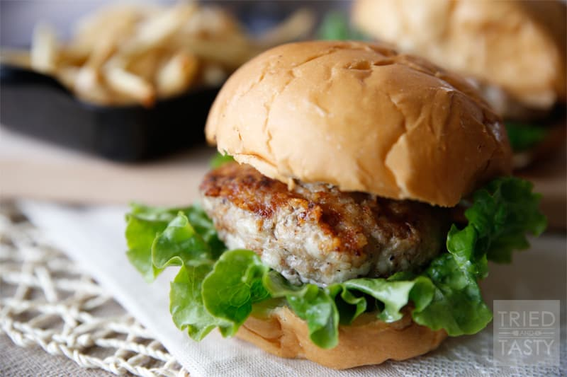 Swiss Turkey Burger // The most amazing ground turkey burger with shredded swiss cheese throughout grilled to perfection! Next time you're grilling, make these! | Tried and Tasty