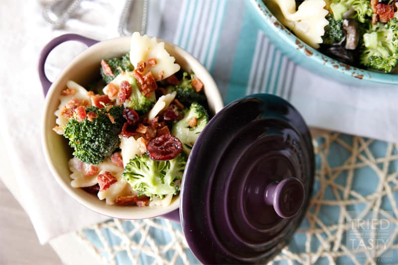 Tasty Broccoli Salad with Dried Cranberries // Need a new salad to take to your next get together? This summery broccoli salad will be an instant hit. Slightly sweet with a little bit of tang, finished off with crunchy bacon bits. Delightful!| Tried and Tasty