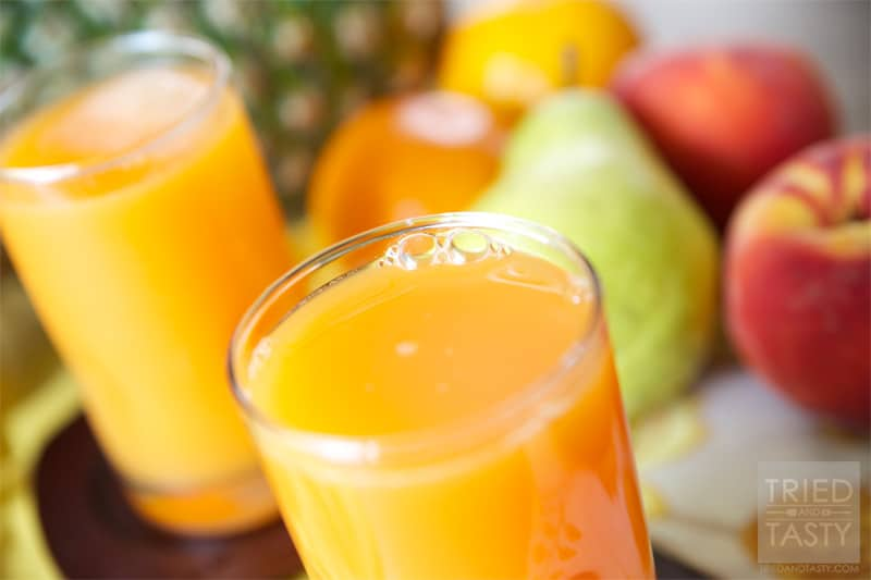 Sippable Orange Sunshine // This Sippable Orange Sunshine is truly like sipping on sunshine. A whole slew of your favorite fruits (and a vegetable) get thrown together for this delicious concoction! | Tried and Tasty