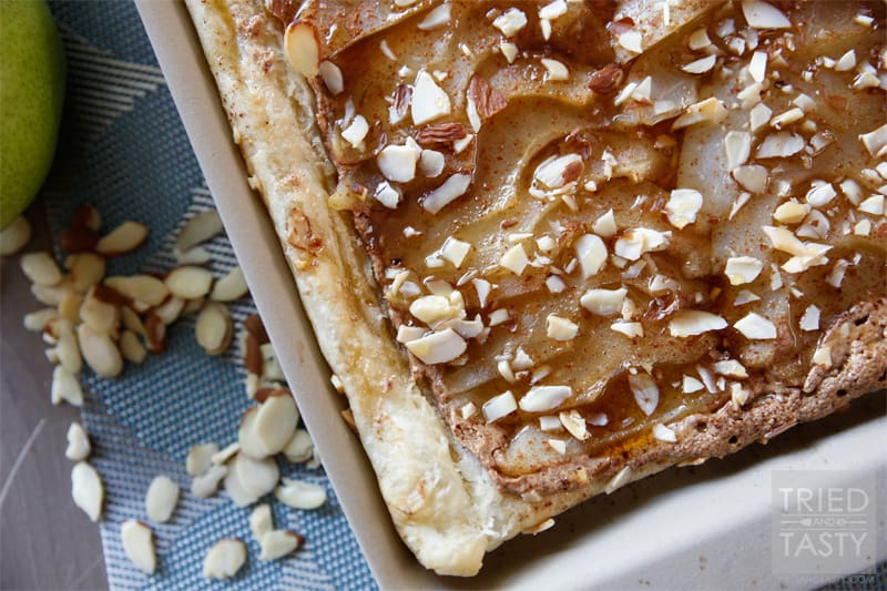 Honey Almond Poached Pear Tart // This Honey Almond Poached Pear Tart is a fancy dessert that looks like you've slaved hours in the kitchen over it. The best part about it? This gorgeous treat comes together with little effort. Your guests will be impressed and your belly will be satisfied! | Tried and Tasty