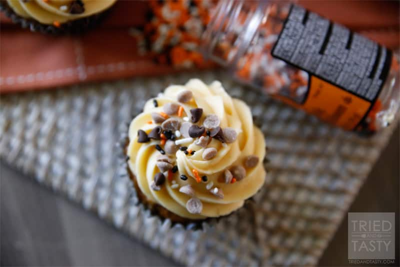 Pumpkin Chocolate Chip Cupcakes w/Pumpkin Cream Cheese Frosting // If you've got canned pumpkin lying around and you aren't sure what to do with it, I would highly suggest making these cupcakes. With the Pumpkin Cream Cheese Frosting, they are pretty much amazing! | Tried and Tasty