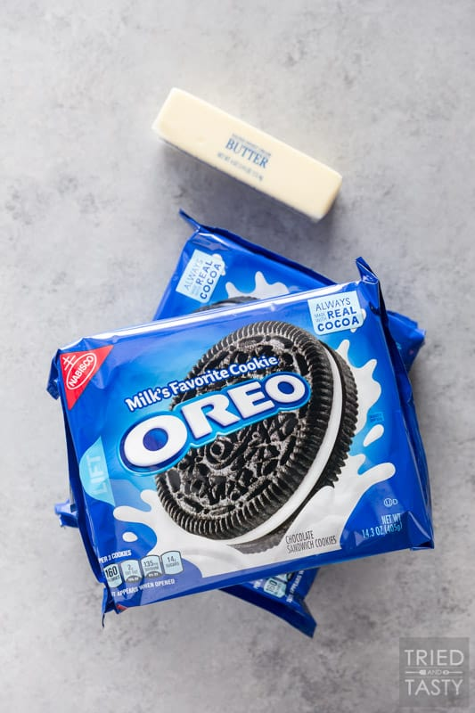 Two packages of Oreo cookies & a stick of butter on the counter