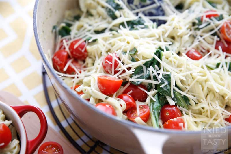 Creamy Spinach Tomato Linguine // A fantastic weeknight meal that you can throw together in a cinch, but looks like you spent hours in the kitchen! The wonderful flavors marry so well together. Tastes great with a slice of your favorite bread! | Tried and Tasty