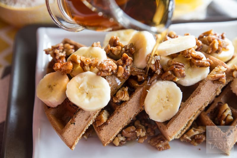 Gluten Free Banana Nut Waffles // These healthy & delicious waffles are the perfect way to start your morning. Made with oat flour, you can have your favorite waffles without any wheat! Topped with maple candied pecans and bananas, they are a treat you don't want to miss! | Tried and Tasty