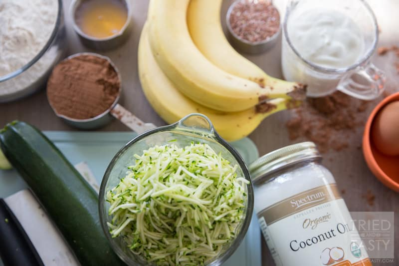 Bakery Style Healthy Chocolate Zucchini Muffins // Do you love bakery style muffins but don't love the long list of unrecognizable ingredients? These Healthy Chocolate Zucchini Muffins are perfect for you! Made without any refined flour or sugar, they are a guilt free breakfast option! | Tried and Tasty