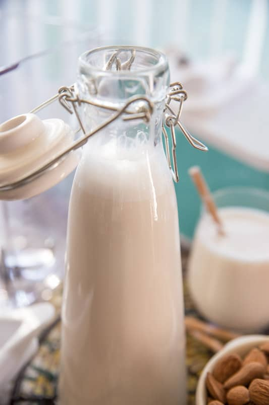 Homemade Almond Milk // Making your own almond milk couldn't be any more simple. All you need are four ingredients and 60 seconds. Best part about it? You avoid Carrageenan the additive found in most store bought almond milks. Enjoy this fresh, smooth, creamy & rich homemade version today! | Tried and Tasty