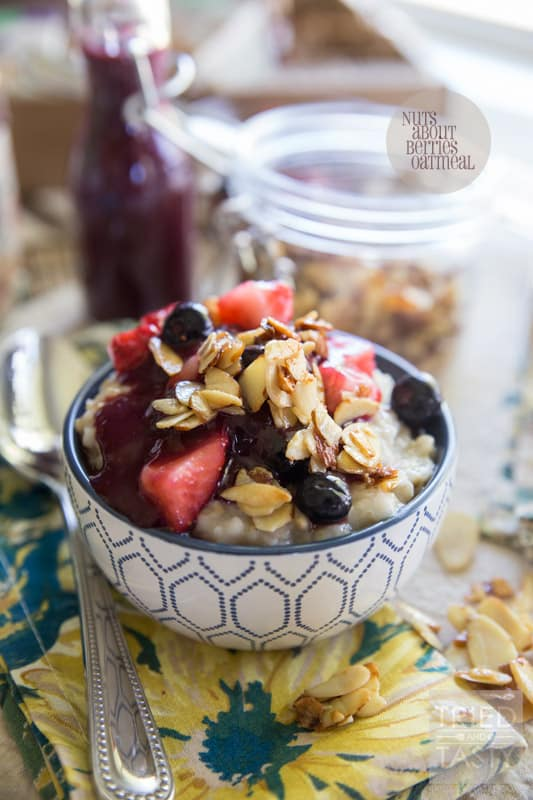 Nuts About Berries Oatmeal // Spice up your breakfast routine with this delicious oatmeal! Topped with fresh berries, warm berry compote, and maple candied almonds. An excellent and hearty way to start your day! |Tried and Tasty