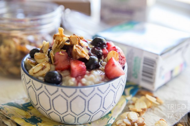 Nuts About Berries Oatmeal // Spice up your breakfast routine with this delicious oatmeal! Topped with fresh berries, warm berry compote, and maple candied almonds. An excellent and hearty way to start your day!  Tried and Tasty