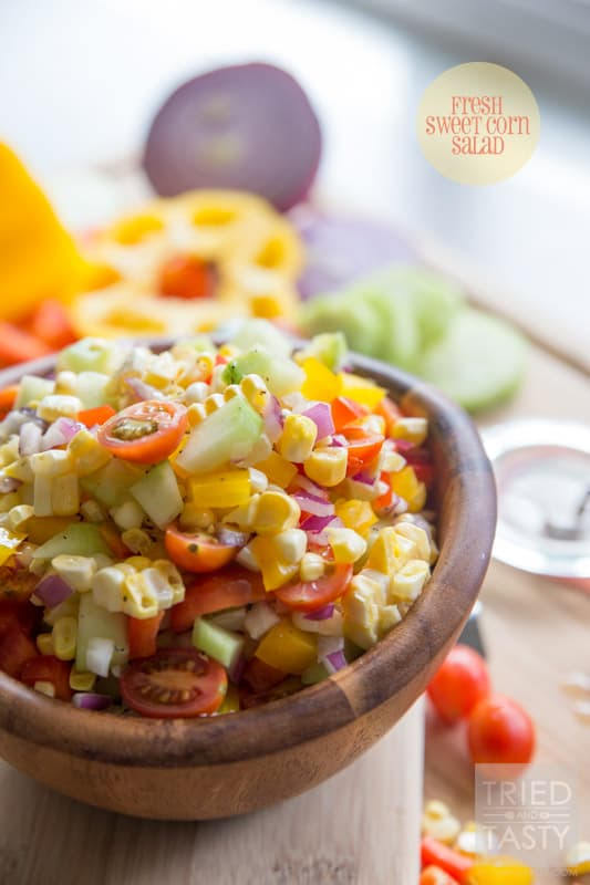 Fresh Sweet Corn Salad // Nothing screams summer like fresh corn! Am I right? I love fresh sweet corn all kinds of different ways, but I especially love it in this yummy salad. Jam packed with all kinds of bright fun veggies, coated in a tangy refined sugar-free dressing! Perfect for any potluck, BBQ, or picnic. | Tried and Tasty