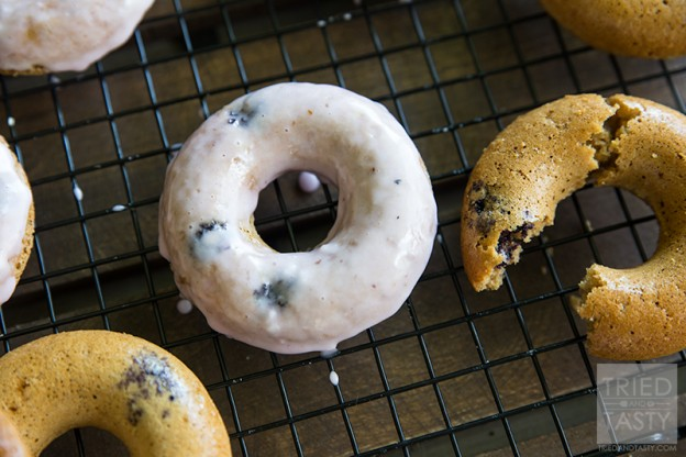 Baked Gluten Free Lemon Blueberry Doughnuts // If you are a doughnut lover but don't want all of the extra calories and sugar, give these baked doughnuts a try. With a little bit of citrus paired with plump & juicy blueberries - these are perfect for breakfast or dessert!   Tried and Tasty