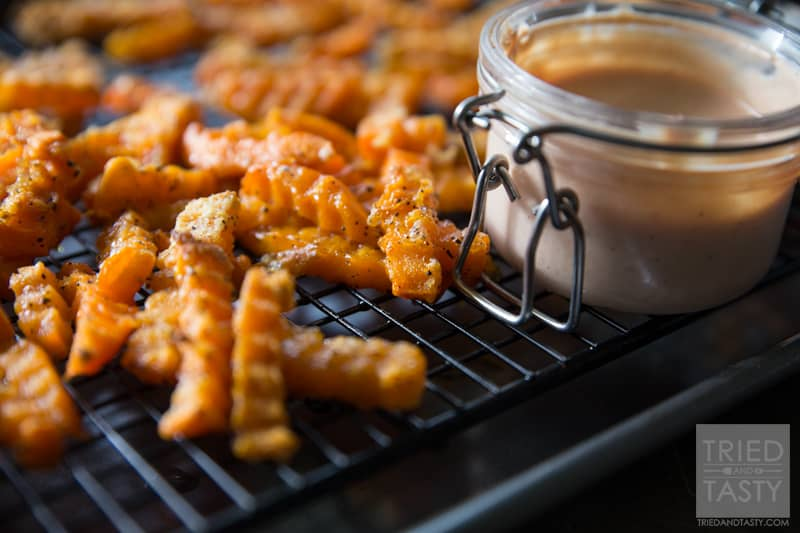 Crinkle Cut Sweet Potato Fries // Why buy storebought sweet potato fries when you can make your own? These are just like what you'd find at the store but only better! With just a few ingredients, these would be the perfect side dish for any grilled hamburgers or hot dogs at your next BBQ! | Tried and Tasty