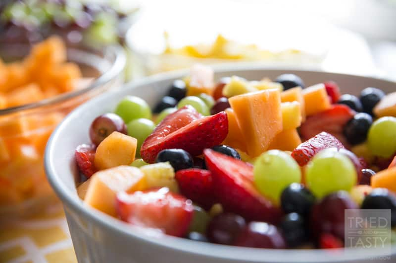 Honey-Lime Sweetened Fruit Salad // Often times you find that a berry salad is loaded with a syrup made with granulated white sugar. The fruit is already sweet as it is, why not add a more simple all-natural syrup to give it the extra hint of sweetness that is needs? This honey-lime sweetened salad is perfect for your potluck, bbq, party, or gathering. Made without any refined sugar - you can feel good about taking that extra scoop! | Tried and Tasty