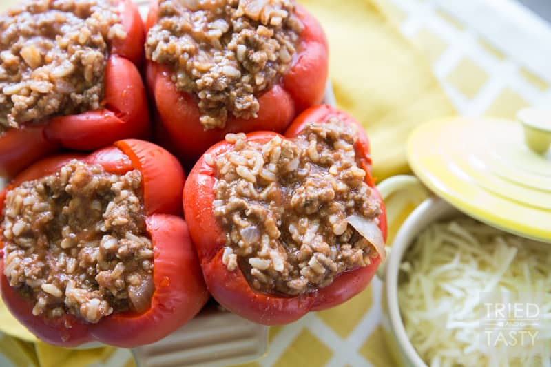 Stuffed Peppers // With only a handful of ingredients, these stuffed peppers are perfect for any weeknight or weekend dinner. Easy, tasty, and perfect for the whole family! | Tried and Tasty