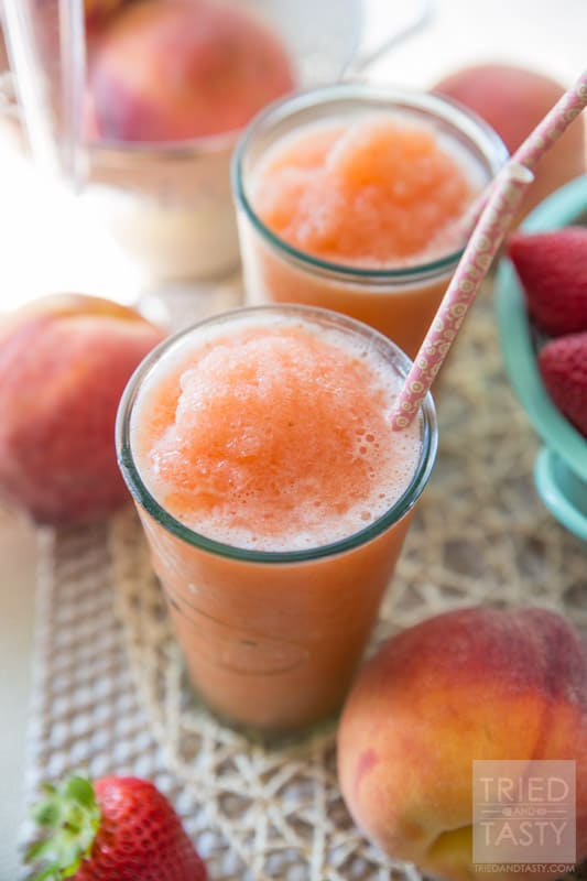 Frozen Strawberry Peach Lemonade // Cool off with this oh-so-refreshing frozen lemonade! A great way to enjoy the high temps without sugar loaded icees, slushes, or freezes. This Strawberry Peach Lemonade is perfect and made without any refined sugar! | Tried and Tasty