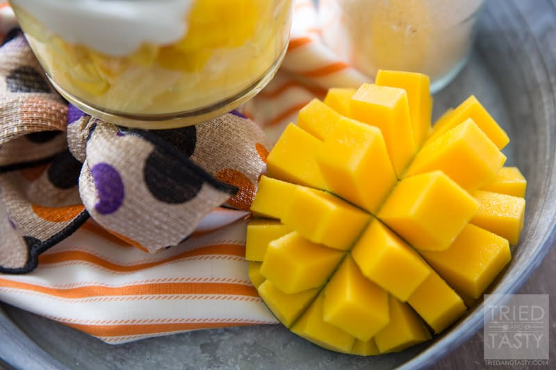 Tropical Candy Corn Parfait // Halloween doesn't have to be ALL about sugar comas. There's healthy ways to celebrate as well! Bring a piece of the tropics close to you with this tropical fruit & yogurt parfait. Layered with pineapple, mango, & coconut yogurt. A delicious & healthy treat! | Tried and Tasty