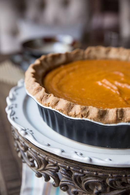 Mom's Sweet Potato Pie // This sweet potato pie is legendary and has been passed down from my grandfather and grandmother to my own mother and now to me. This is the MUST HAVE recipe of the fall season that can be enjoyed for Halloween, Thanksgiving, and any other day of the year! The perfect addition to any dessert table. | Tried and Tasty