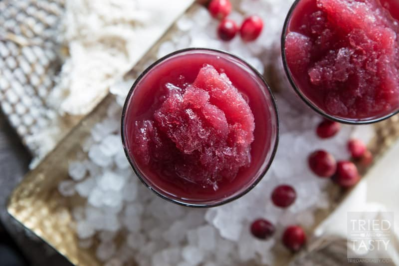 Cran-Pomegranate Citrus Slushie // The tangy flavors of this power packed slushie will have your tastebuds dancing to a new tune! Non-alcoholic and perfect for all of the guests at your holiday party! | Tried and Tasty