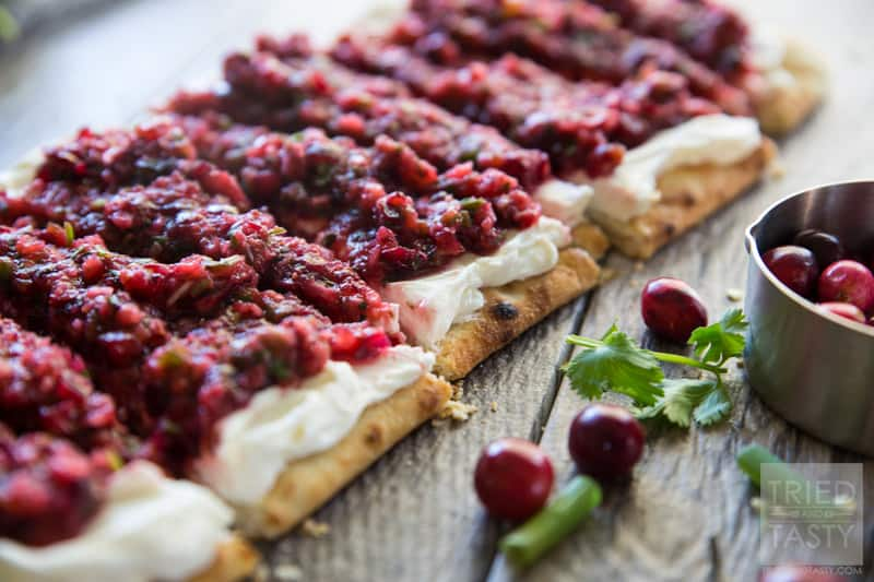 Cranberry Salsa Flatbread Appetizer // Want a delicious & festive appetizer for the holidays? You're in luck! This cranberry salsa will wow your guests tastebuds at first bite! | Tried and Tasty