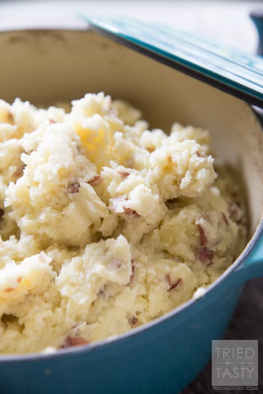 Close up shot of mashed red potatoes in a turquoise dutch oven