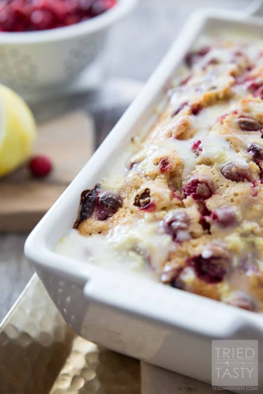 Lemon Cranberry Bread // This gorgeous citrus sweet bread is not only a stunner, but perfect for your holiday dessert table. A little bit of tart, a little bit of sweet, and a whole lot of delicious! | Tried and Tasty