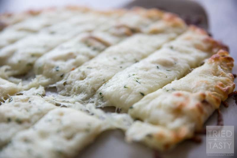 Copycat Pizza Hut Cheese Sticks // Why go out when you can have your restaurant favorites right at home? These Copycat Pizza Hut Cheese Sticks are perfectly cheesy and wonderfully delicious. On top of all of that, they are crazy simple and less than FIVE ingredients! | Tried and Tasty