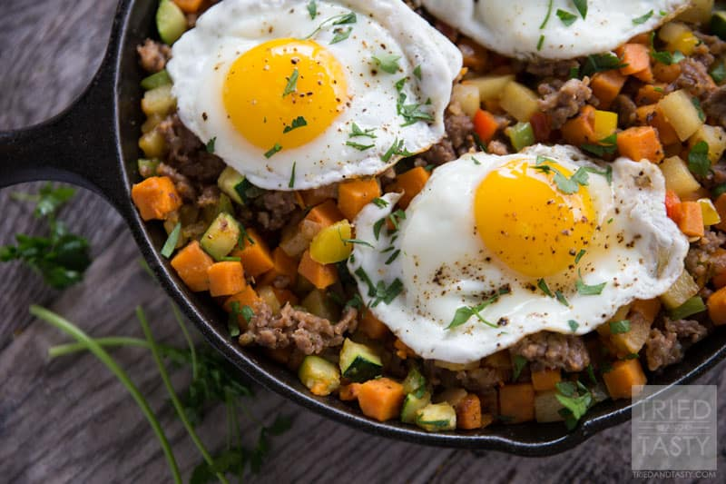 Sweet Potato & Sausage Breakfast Hash // Looking for a filling, delicious, and healthy breakfasT? This sweet potato & sausage hash is an excellent choice. Loaded with veggies and more - you'll want to start every morning with this tasty dish! | Tried and Tasty