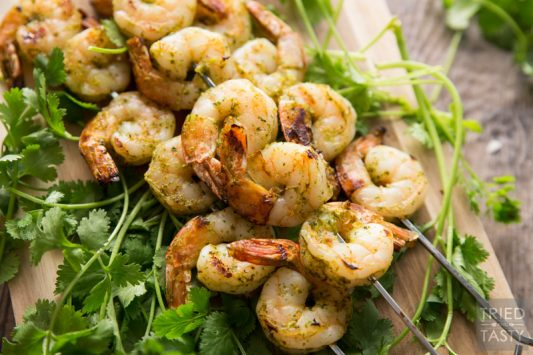 Cilantro Honey Lime Marinade // This simple to throw together marinade requires minimal chopping and all the hard work is completed by your blender. Throw all your juices and spices together, blend, then marinate your shrimp (or other meat of choice). Throw it on the grill and you've got the perfect summertime grilled grub!   Tried and Tasty