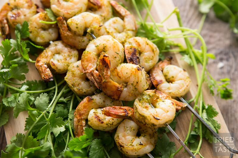 Cilantro Honey Lime Marinade // This simple to throw together marinade requires minimal chopping and all the hard work is completed by your blender. Throw all your juices and spices together, blend, then marinate your shrimp (or other meat of choice). Throw it on the grill and you've got the perfect summertime grilled grub! | Tried and Tasty