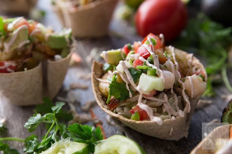 Shrimp Taco Cups // Made with Flatour MuliGrain with Flax Flatbread, these Shrimp Taco Cups are a unique way to throw a Mexican Fiest dinner party. Packed with flavor in the knockout combo of marinated grilled shrimp AND topped with a zesty shrimp ceviche! | Tried and Tasty